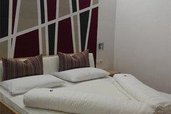 Schlafzimmer Ferienwohnung Ost